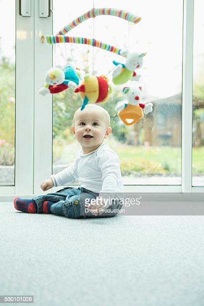 Toddler looking at mobile