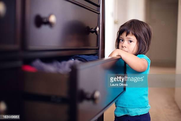 Toddler Looking In Dresser Drawer