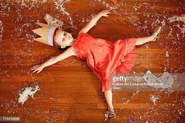 Toddler lying on dirty wooden floor