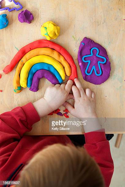 Toddler Making a Rainbow with Clay