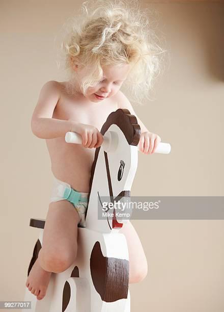 Toddler on rocking horse