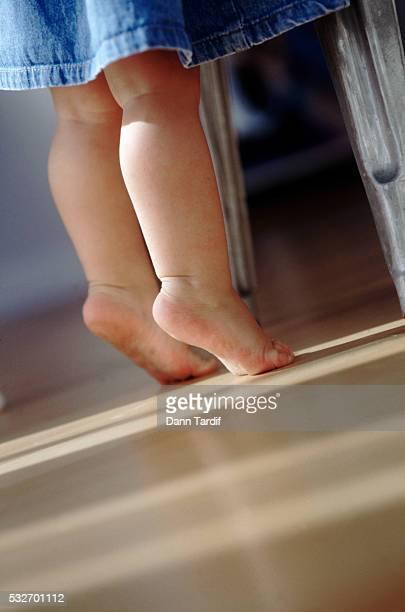 Toddler on tiptoes
