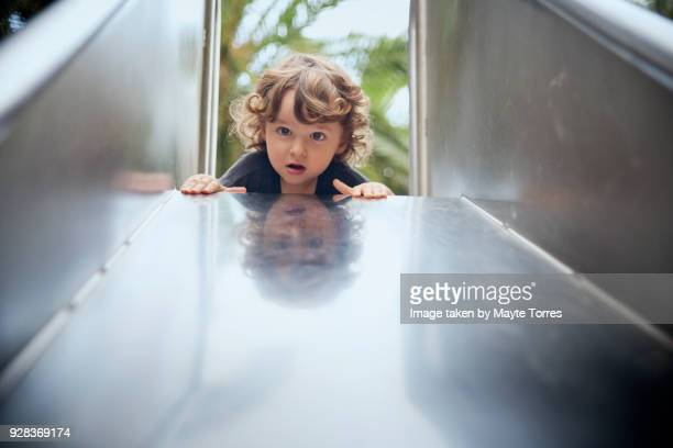 Toddler on top of the slide