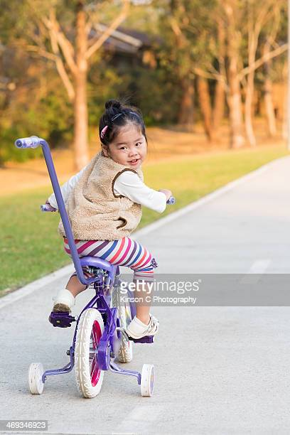 Toddler on tricycle looking back