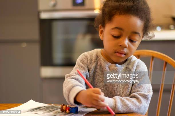 toddler painting at the kitchen table - writer stock pictures, royalty-free photos & images
