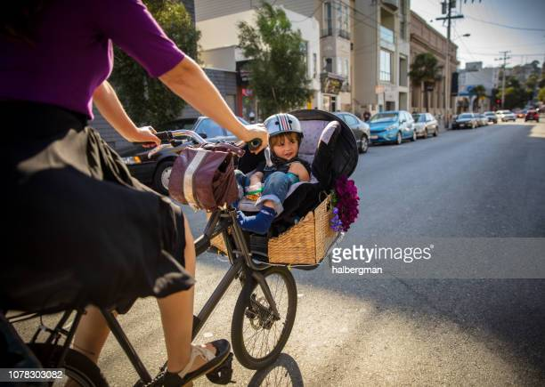 Toddler Peering Out From Bicycle Child Seat