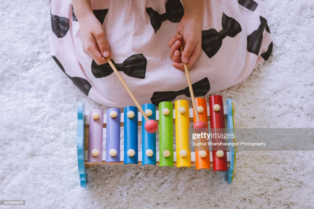 Toddler playing a xylophone at home : Stock Photo