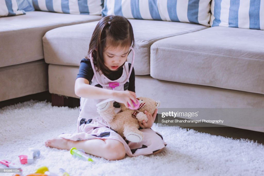 Toddler playing Doctor role : Stock Photo