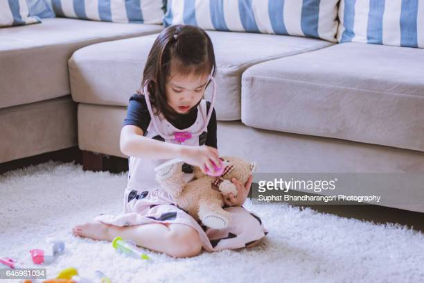 Toddler playing Doctor role