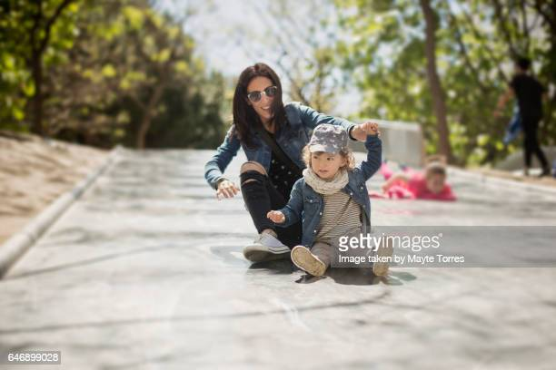 toddler playing in a giant slide with auntie - aunt stock pictures, royalty-free photos & images