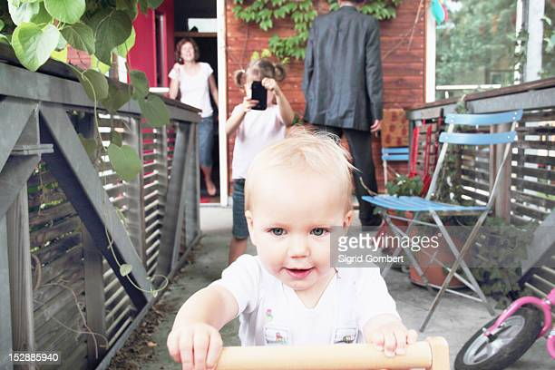toddler playing in backyard - sigrid gombert stock pictures, royalty-free photos & images