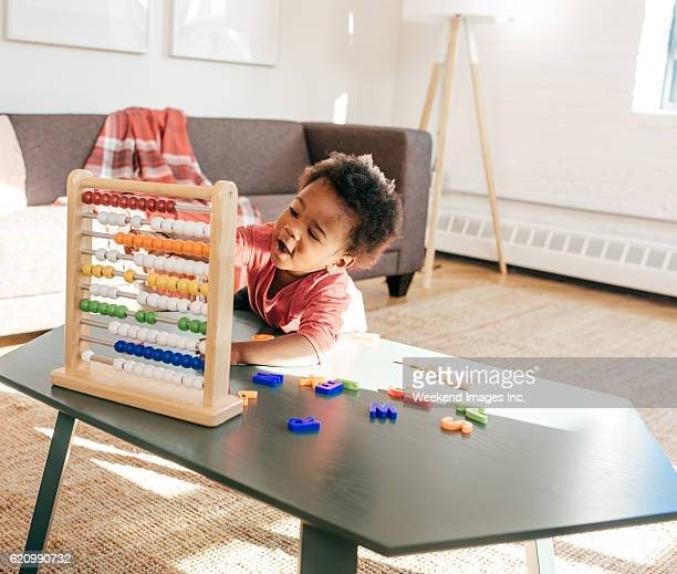 Toddler playing in living room be herself