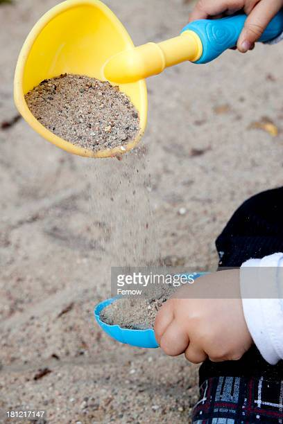toddler playing in sandpit - 2 girls 1 sandbox stock photos and pictures