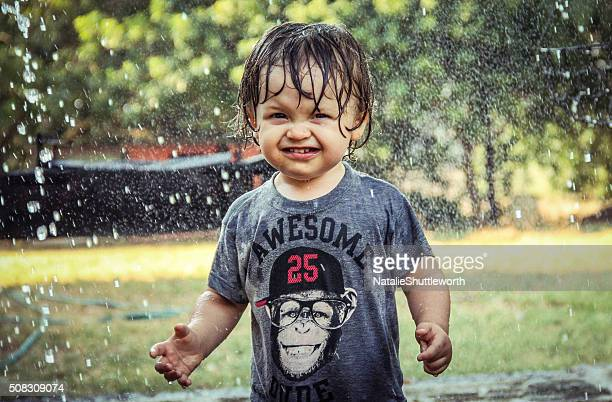 Toddler playing in the rain