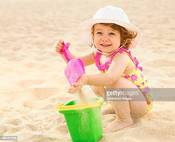 Toddler playing on beach