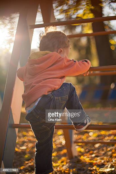 toddler playing on playground - klein stock pictures, royalty-free photos & images