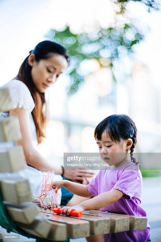 Toddler playing traditional chinese rabbit lantern : Stock Photo