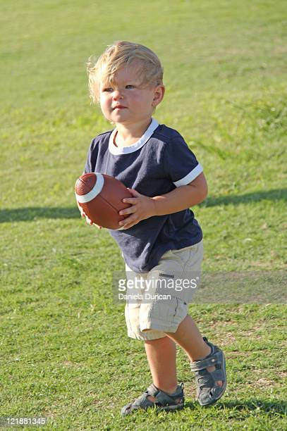 Toddler Playing with American Football