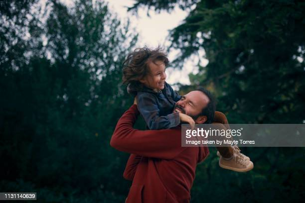 toddler playing with dad - autism awareness stock pictures, royalty-free photos & images