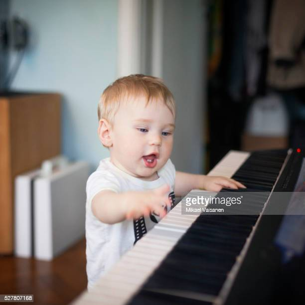 Toddler (2-3) playing with electric piano