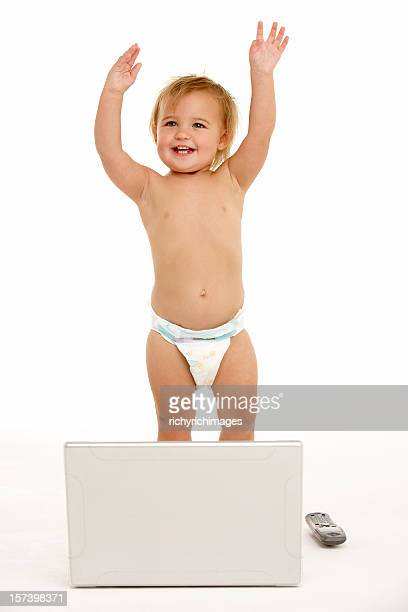toddler playing with laptop - diaper kids stock pictures, royalty-free photos & images