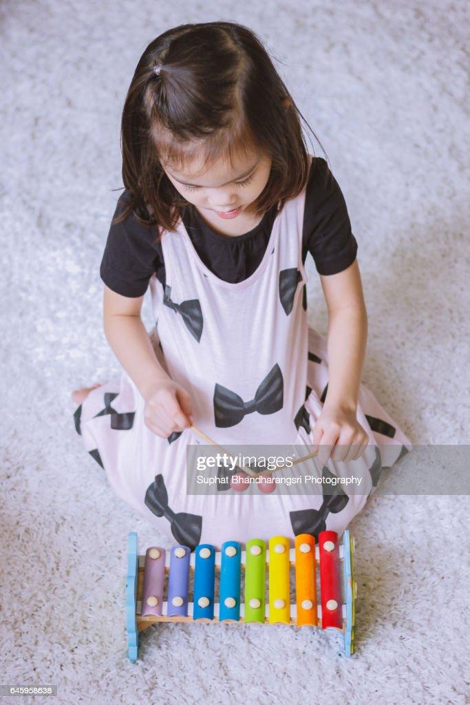 Toddler practising new music lesson : Stock Photo