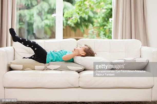Toddler relaxing on sofa