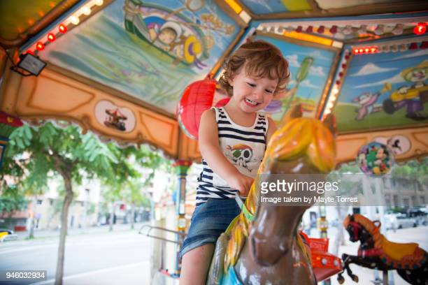 Toddler riding horse in the carrousel