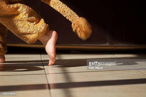 Toddler running in lion costume