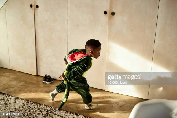 toddler running through house in dragon costume - playing stock pictures, royalty-free photos & images
