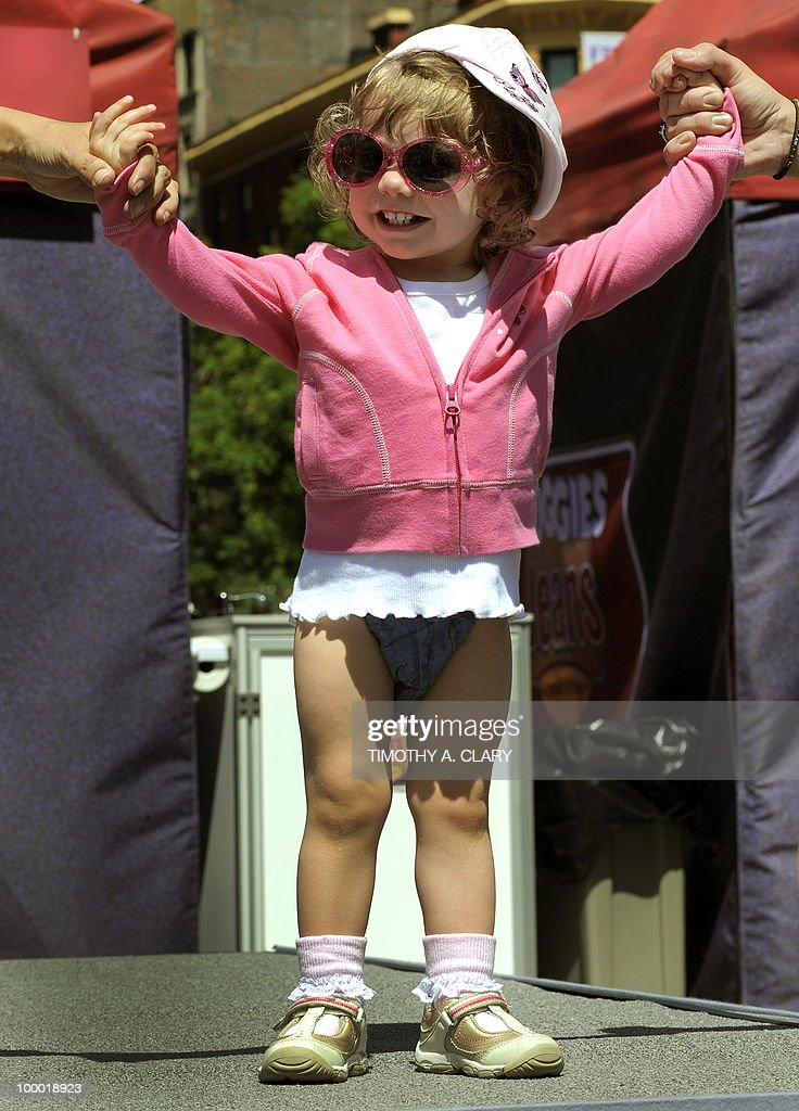 A toddler shows off the new Huggies Little Movers Jeans Diapers during the 'What's Your Denim Style' baby fashion show in Union Square May 20, 2010. The all-new jeans design by Huggies are the new look for summer.