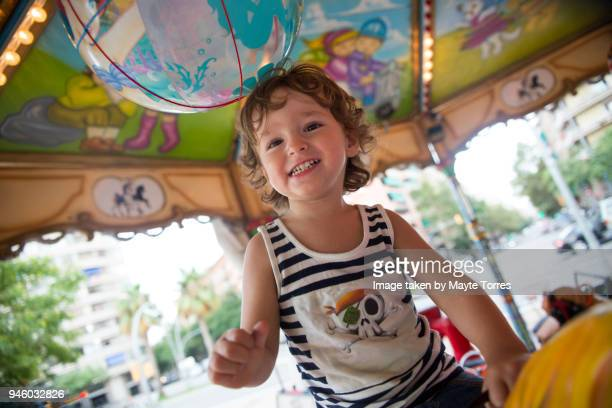 Toddler smiling at the carrousel