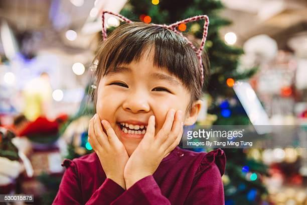 Toddler smiling joyfully at camera