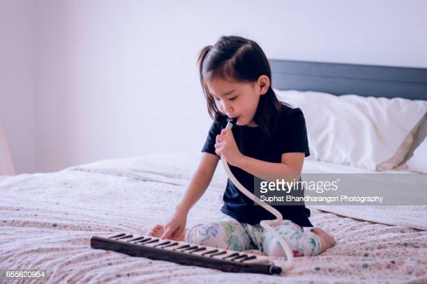 Toddler soloing on melodian