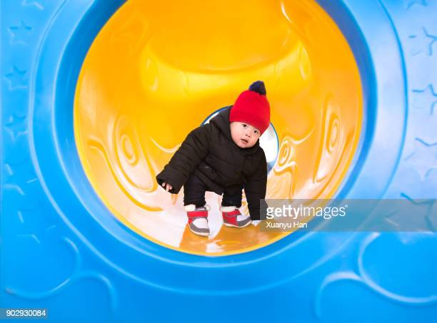 toddler standing in a playground - man made structure stock pictures, royalty-free photos & images