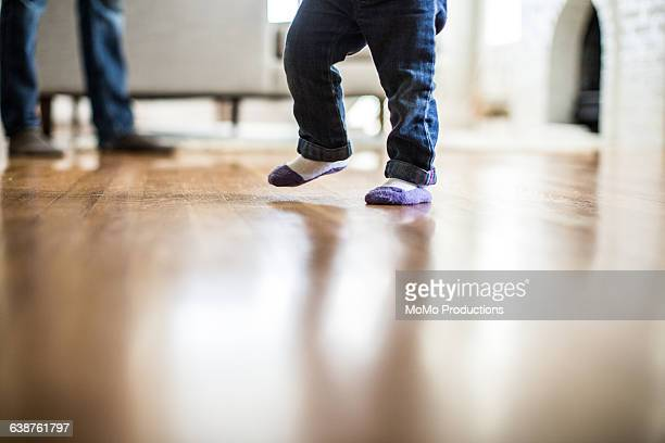 toddler taking 1st steps