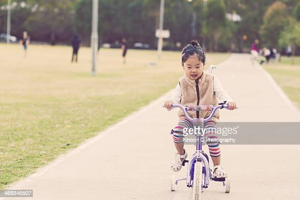 Toddler tiding a tricycle