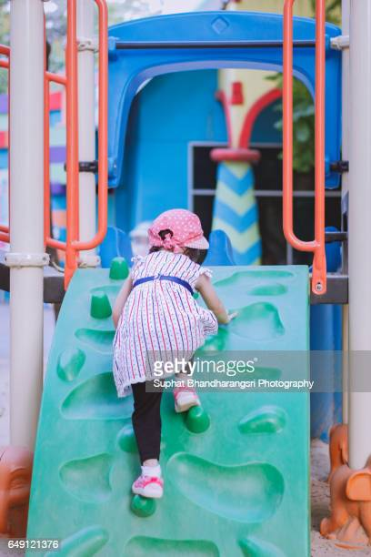 Toddler trying to climb the playhouse