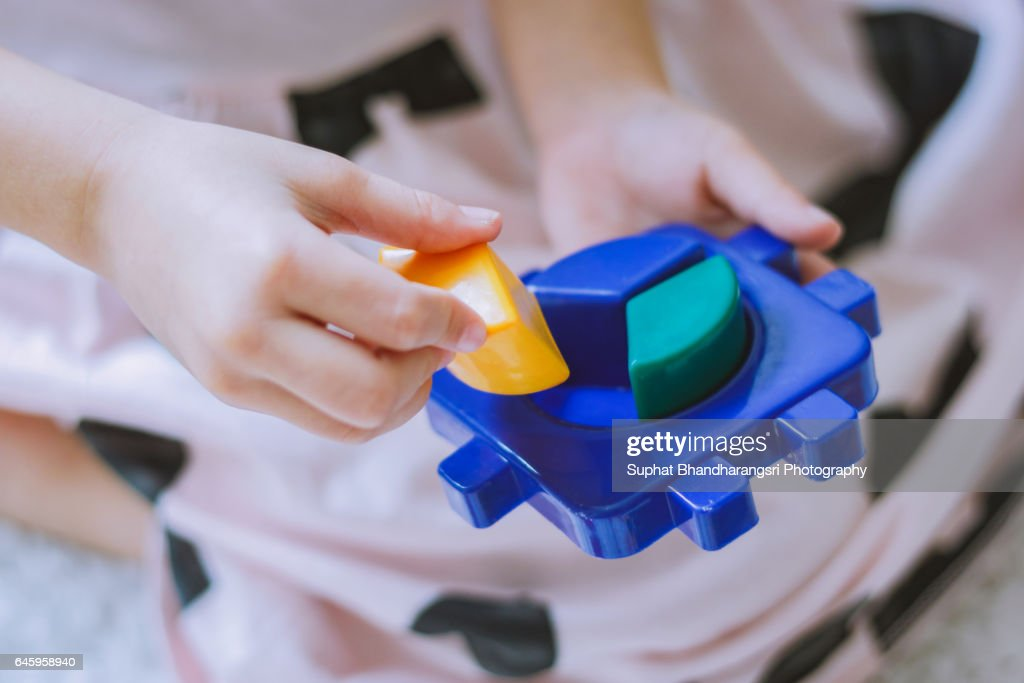 Toddler trying to fill the pie chart : Stock Photo