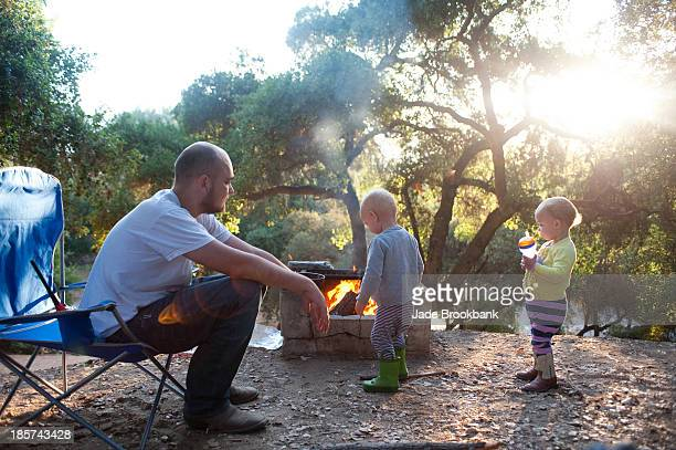 Toddler twins on camping site with father