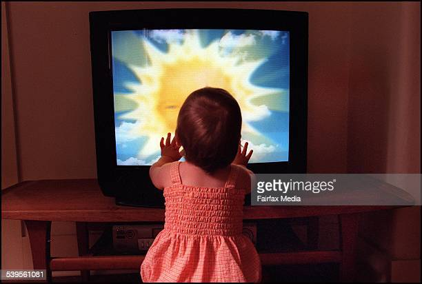 A toddler watches Teletubbies on television set on 28 December 2001 AFR GENERICS Picture by LOUISE KENNERLEY