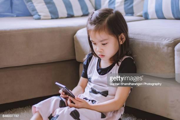 Toddler watching a cartoon smartphone screen
