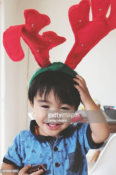 Toddler wearing a reindeer antler headband for Christmas