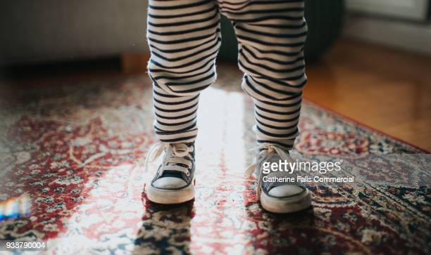 toddler wearing sneakers - blue shoe stock pictures, royalty-free photos & images