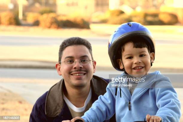toddler with father riding bike