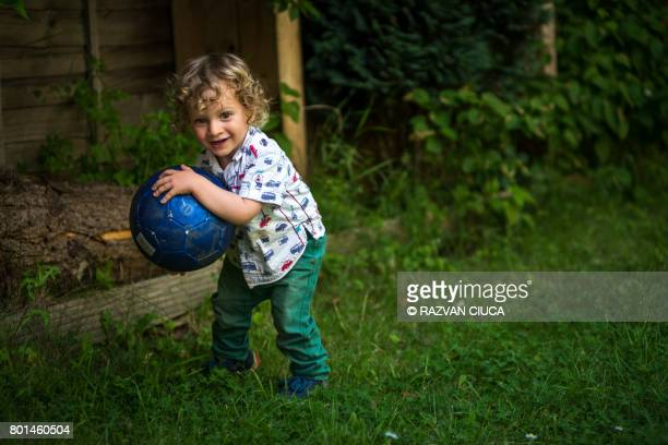 Toddler with football