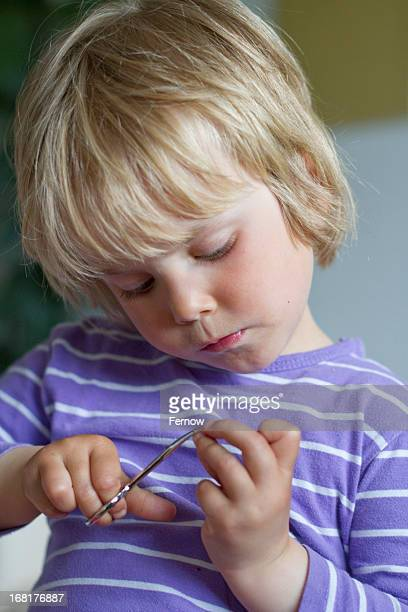 toddler with nail scissors - nail scissors stock pictures, royalty-free photos & images