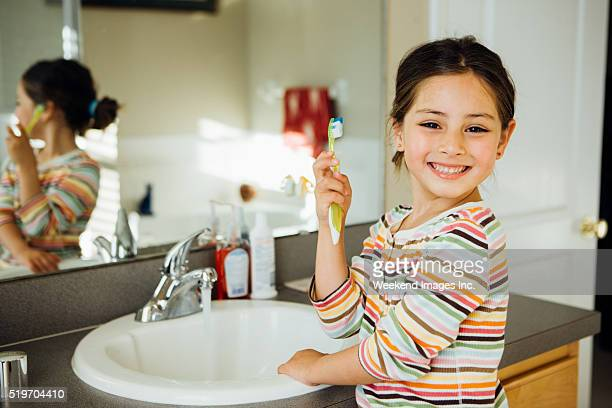 Toddler with toothbrush
