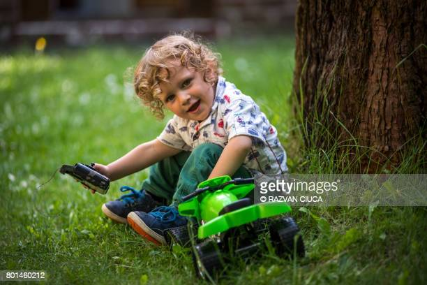 Toddler with toy car