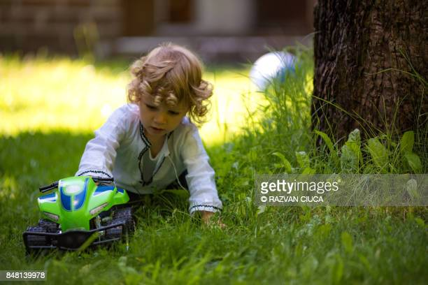 toddler with toy car - rc car stock photos and pictures